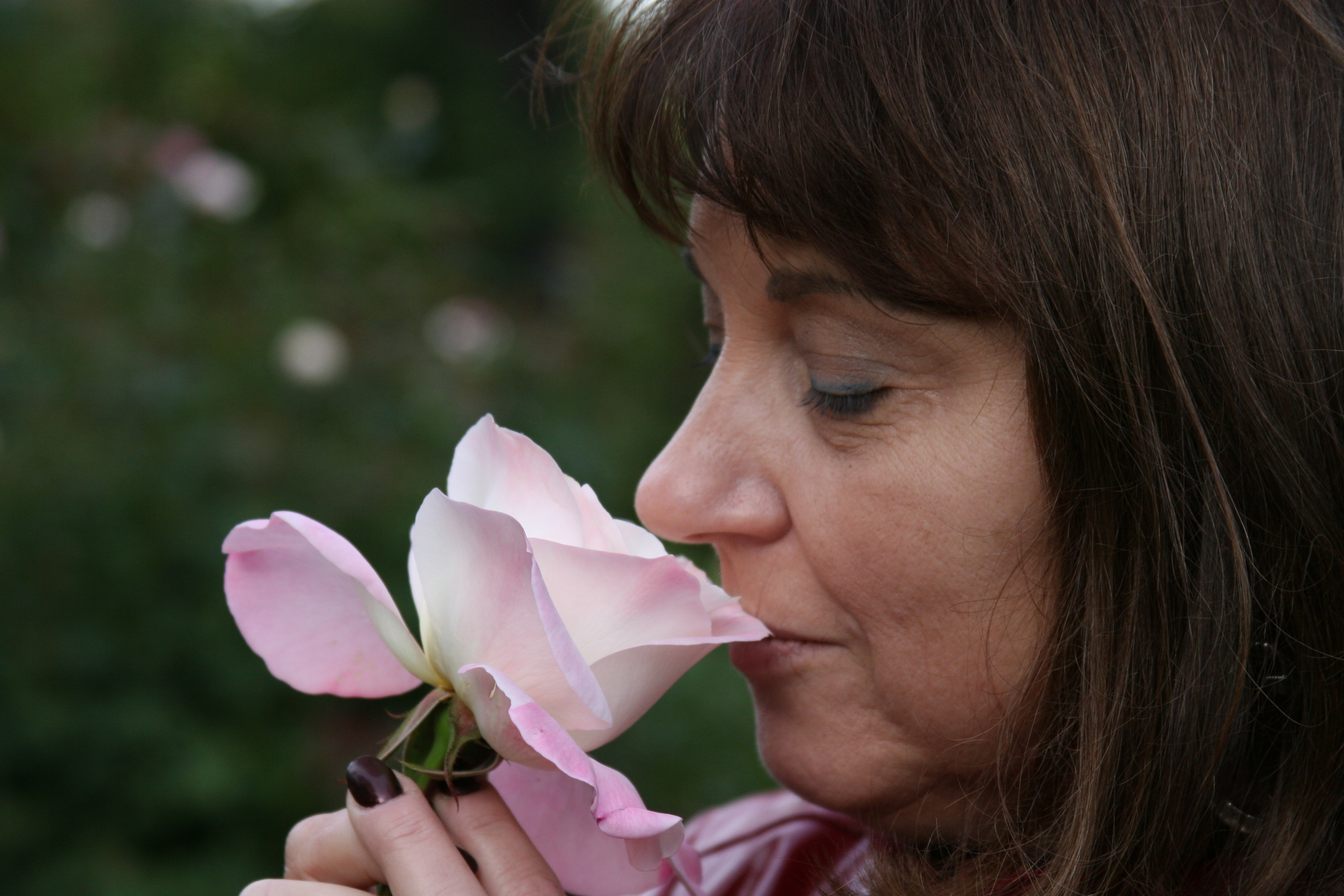 Me sniffing a rose from the Rose Garden - taken by my husband